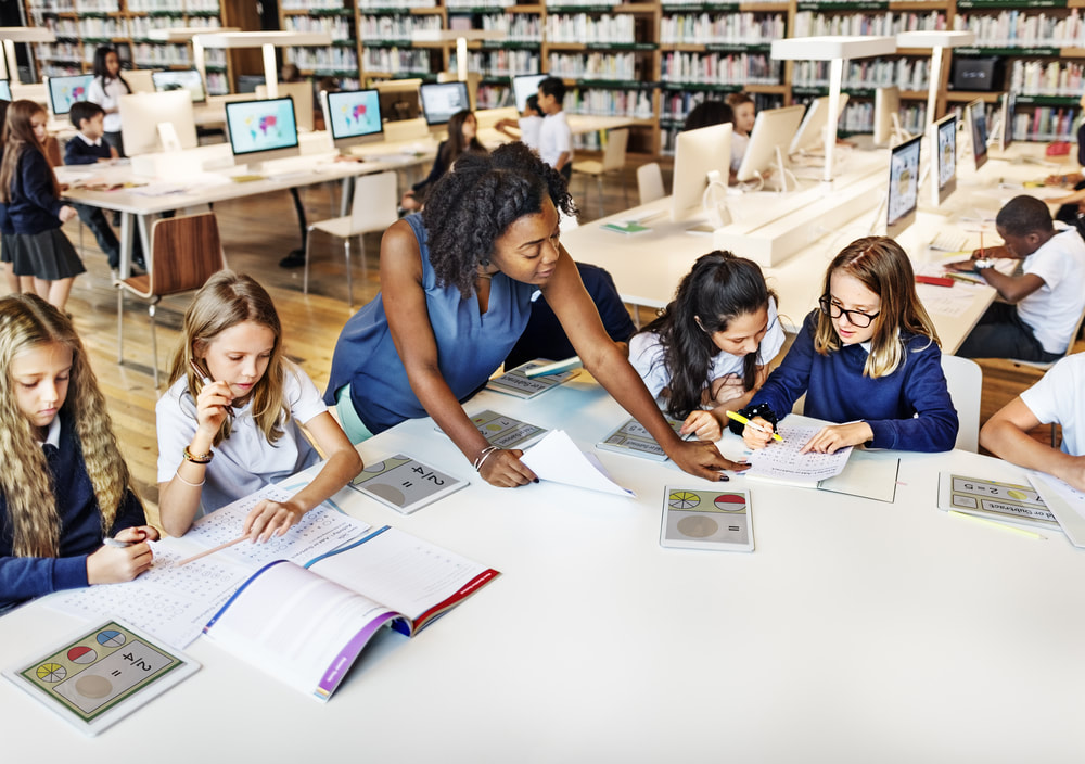 woman-teacher-girl-students-library_1